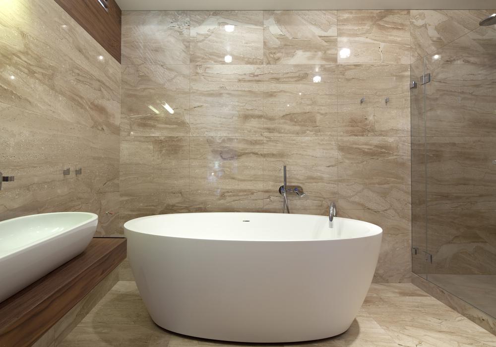 Freestanding bath in tiled bathroom