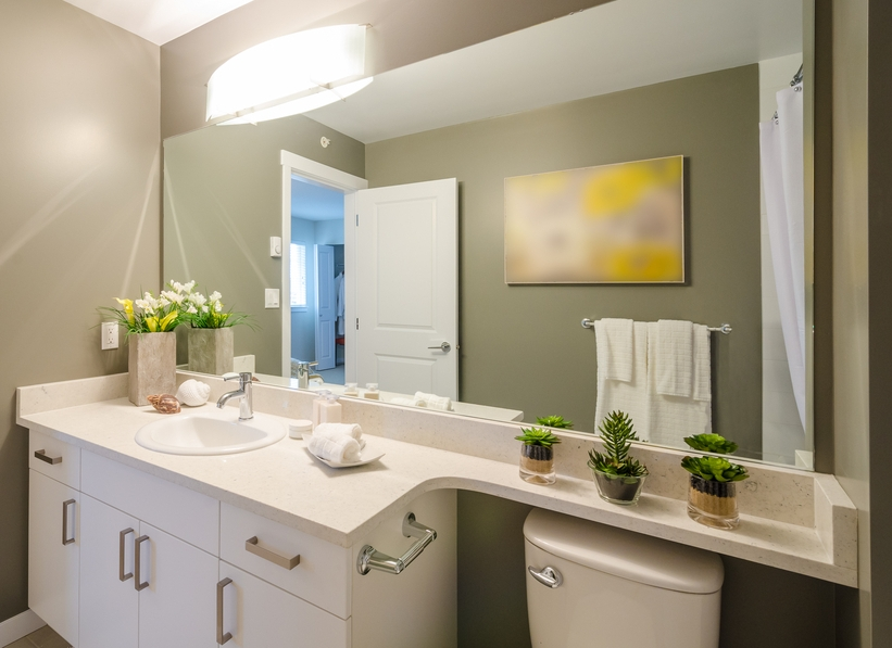 Large bathroom mirror in small workspace